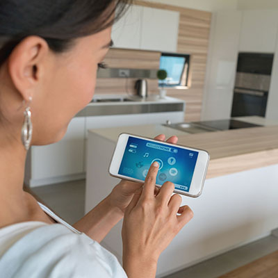 Woman using smart home app on her cell phone